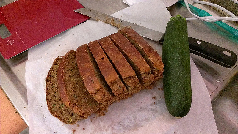 Zucchini bread with a zucchini in a dirty kitchen